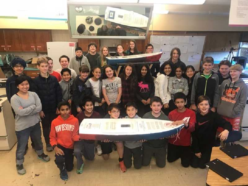 COURTESY: HEIDE VANDENHOOFF - Everyone in Heide vandenHooff's seventh grade science class had a different job to complete in preparing their boats for launch.