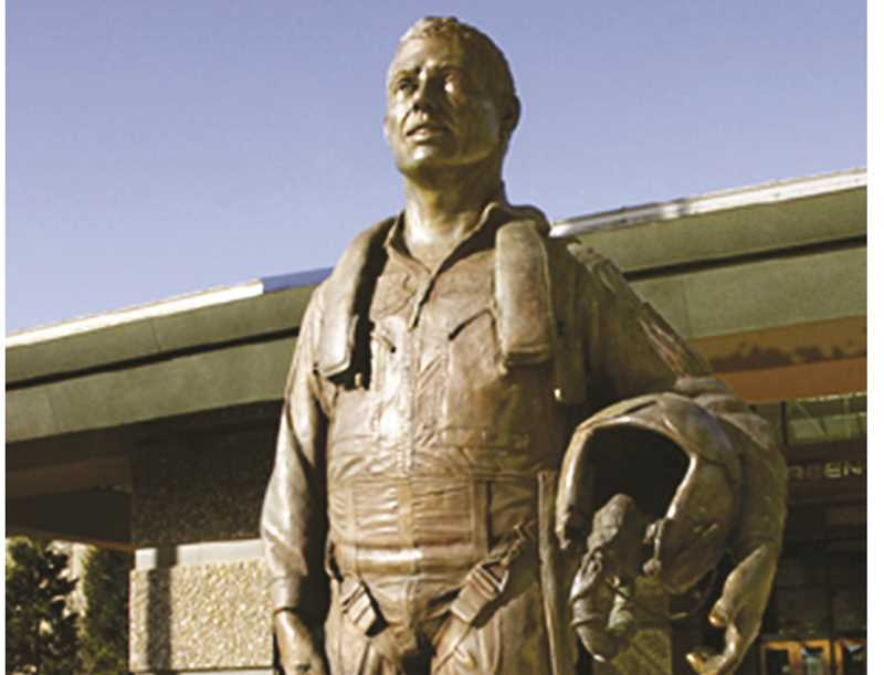 SUBMITTED PHOTO - Bill Bane's nine-foot bronze memorial sculpture of Captain Michael King Smith is placed in front of the Evergreen Air Museum building in McMinnville.