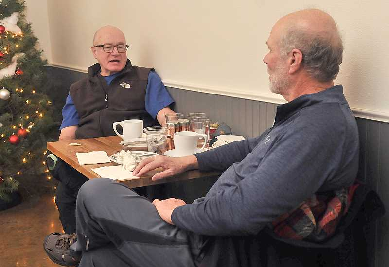 TIDINGS PHOTO: VERN UYETAKE - Jeff Kozy, left, and James Patterson enjoy a coffee at Lark Café. Historic Willamette's new director is hoping to add to the events that would bring more people downtown.