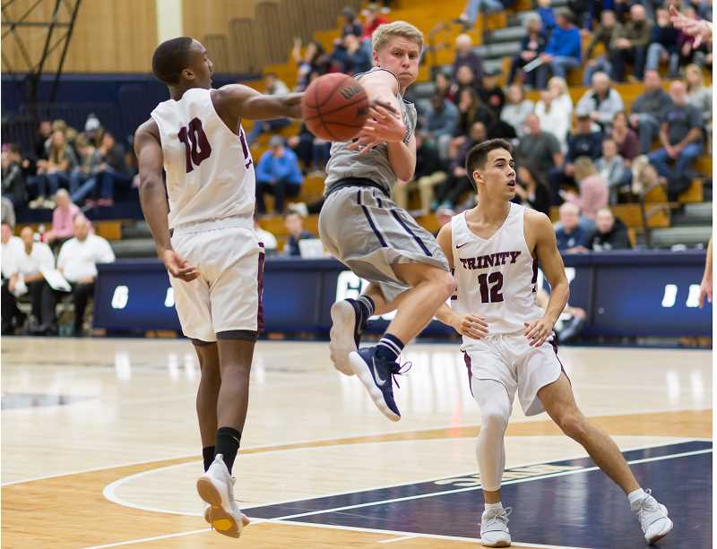 GEORGE FOX UNIVERSITY - Freshman guard Jeff Januik goes airborne to get off a pass during George Fox's 92-85 home victory over Trinity (Texas) Saturday night at Miller Gymnasium.