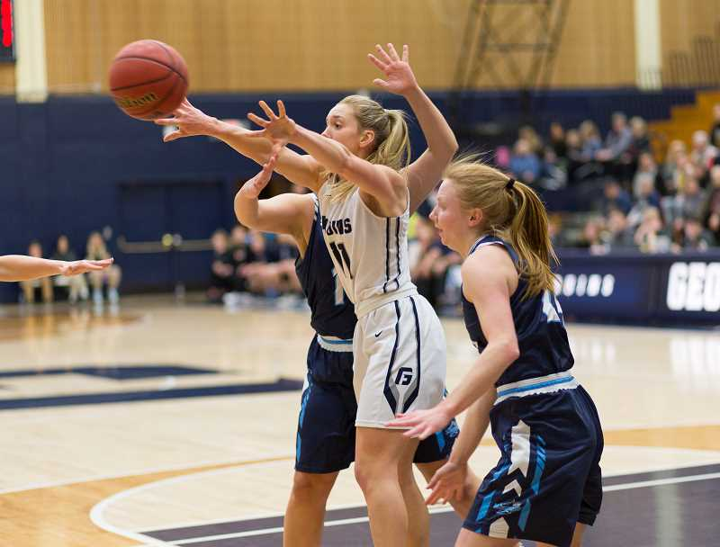 GEORGE FOX UNIVERSITY - George Fox junior wing Haylee Hutzler passes out of a trap during George Fox's 92-50 home win over Vancouver Island (Can.) Sunday at Miller Gymnasium.