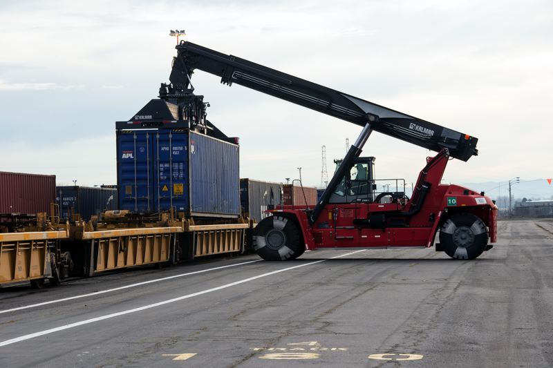 COURTESY: PORT OF PORTLAND - Containers have been arriving by truck at the Port of Portland's Terminal 6 since before Christmans. Now they are being loaded on to a new rail shuttle to Puget Sound Ports as an alternative to road.