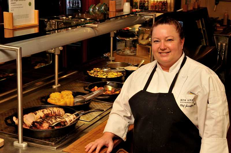 STAFF PHOTOS: VERN UYETAKE  - Chef Jennifer Peck invites everyone to eat at the Savor Cafe on the Marylhurst University campus. The cafe offers a wide selection of dishes and accomodates many eating preferences.