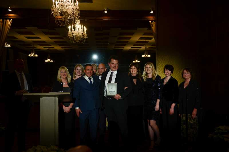 SUBMITTED PHOTO HOME BUILDERS ASSOCIATION - The Mountainwood Homes team was honored as Remodeler of the Year at the HBA Builders Ball Dec. 1. Pictured are from left Cindy Bauer, Lyndy Wolfram, Lee Schider, Johnyne Donnelly, Ivan France, Robert Wood, Heather Wood, Alicia DeCosta, Sierra Lemieux and Jean Johnson.