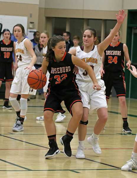 COURTESY PHOTO - Forest Groves Kinsey Barnett defends during the Vikings' tournament game against Roseburg at the Les Schwab Holiday Oregon Hoopfest in Bend.