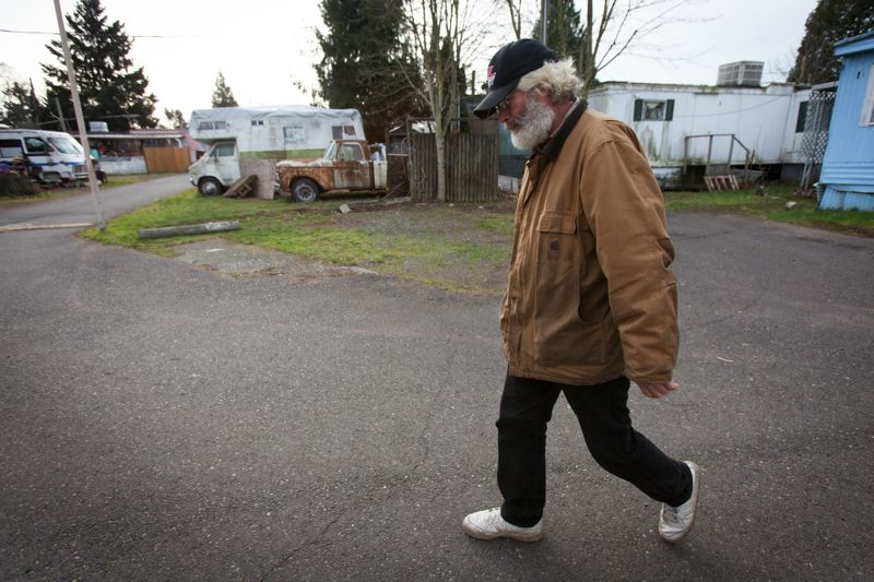 TRIBUNE PHOTO: JAIME VALDEZ  - Greg Nelson, an 18-year Oak Leaf resident, likes owning his own home. He lives in the Dodge Sportsman RV to his right thats next to the battered old truck, which he also owns.