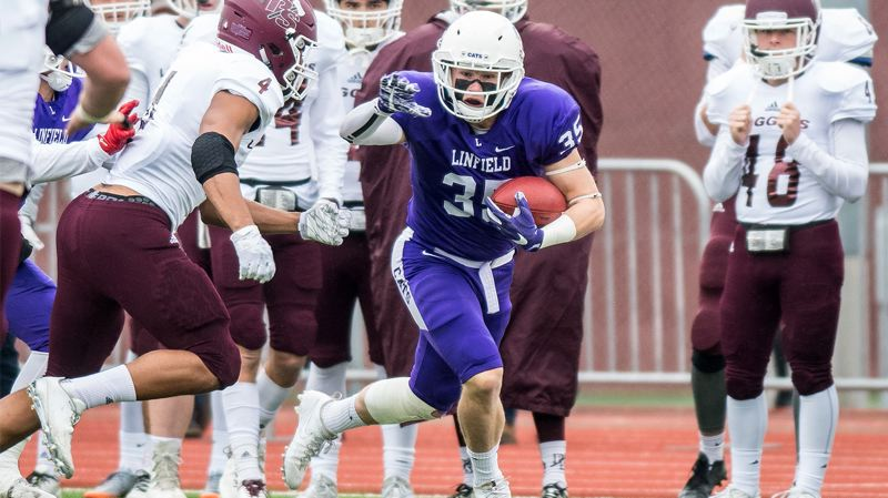 LINFIELD COLLEGE COMMUNICATIONS - Sherwood High School graduate Jake Reimer, a linebacker for Linfield College, heads up field after intercepting a pass during the Wildcats' 23-0 win over Puget Sound.