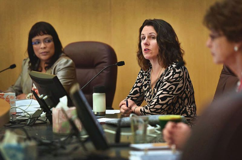 TRIBUNE FILE PHOTO - Members of the community, including allies of Commissioner Loretta Smith (left) turned out Thursday to criticize Chair Deborah Kafoury (middle) over her use of an epithet to publicly describe Smith late last month.