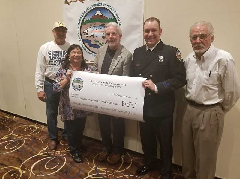 PHOTO COURTESY OF MOLALLA FIRE - Molalla Firefighter Paramedic Rob Boren accepts the award at the Siletz Tribal contribution banquet.