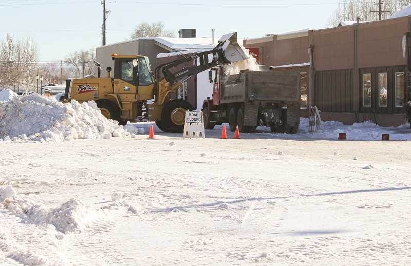 CENTRAL OREGONIAN FILE PHOTO - City public works staff members remove snow from the streets of downtown Prineville after multiple snow storms hit the community in December and January.