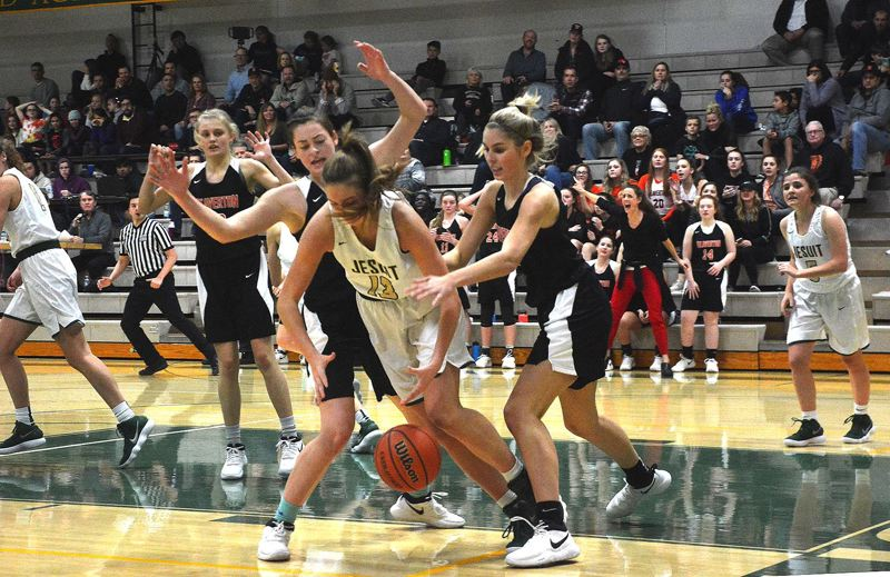 TIMES PHOTO: MATT SINGLEDECKER - Beaverton forwards Cierra Speck and Isabelle Pots put pressure on Jesuit in the second half of their win over the Crusaders on Jan. 3.