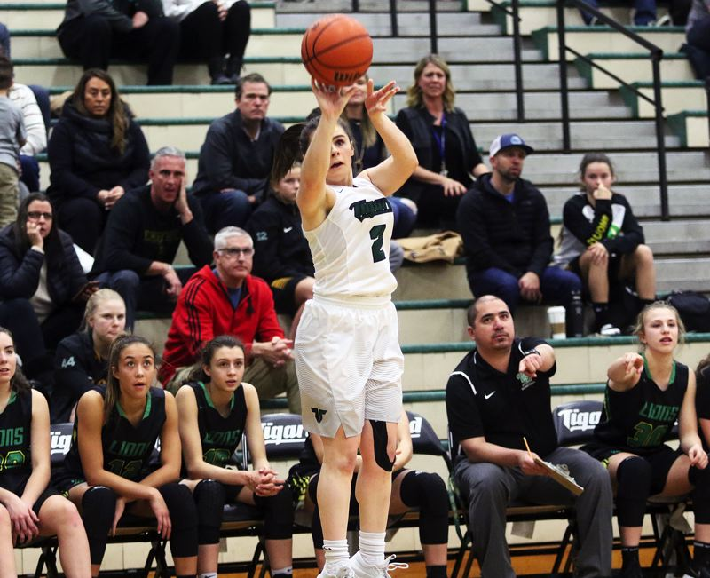 DAN BROOD - Tigard sophomore Kennedy Brown sinks a three-pointer early in the game during the Tigers' win over West Linn.
