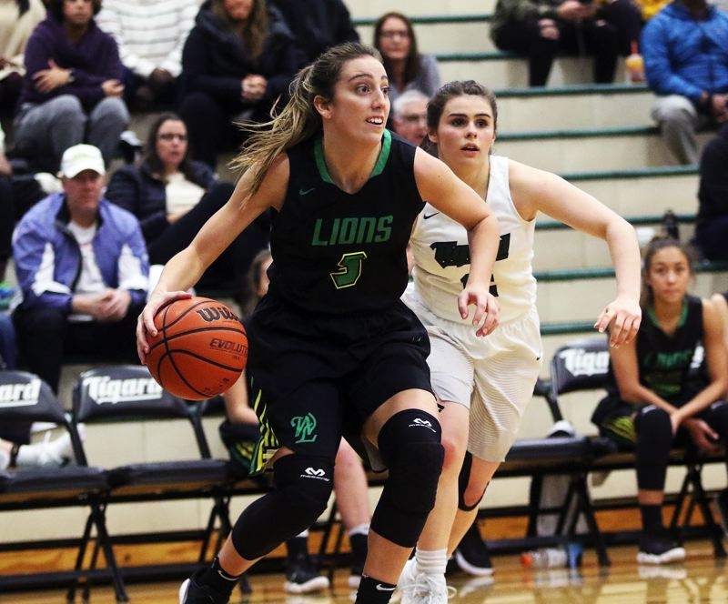 DAN BROOD - West Linn senior Lexie Pritchard looks to make a move on the baseline during Wednesday's game at Tigard.