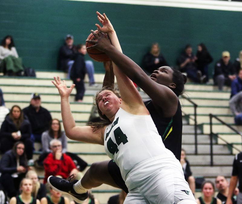 DAN BROOD - Tigard junior Dani Lyons (44) and West Linn freshman Aaronette Vonleh battle for the ball during Wednesday's game.
