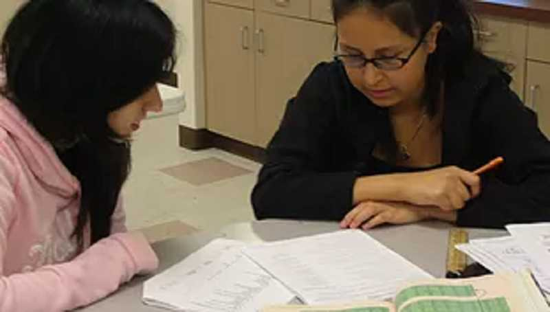 COURTESY PHOTO - A CREATE staff member helps a student at CREATE, a Forest Grove High School alternativ program for students who need small classes.