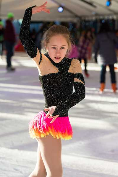 HILLSBORO TRIBUNE PHOTO: CHRISTOPHER OERTELL - Alena Budko, 10, shows off her skills at Hillsboros Winter Village skating rink in December, ahead of the U.S. Figure Skating Championships in San Jose, Calif., where she placed fourth.