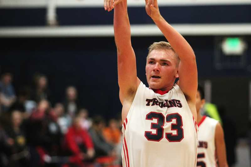 PHIL HAWKINS - Kennedy junior Carson Hall led the Trojans with 14 points, eight rebounds, five assists and three steals in the team's 31-point victory over Central Linn on Friday.