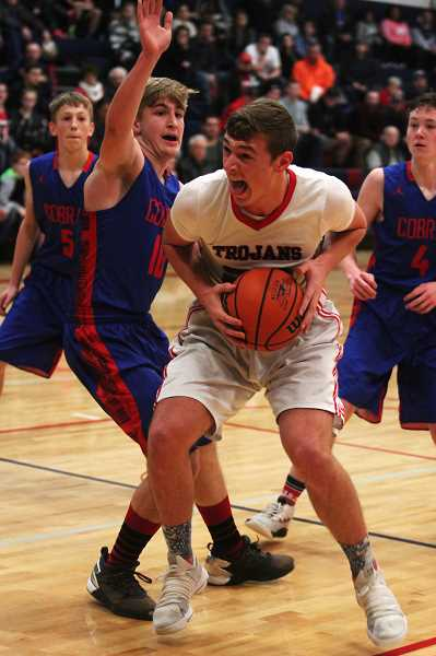 PHIL HAWKINS - Kennedy junior Rocco Carley scored seven of his 10 points in the first half of the Trojans' 68-37 win over Central Linn.