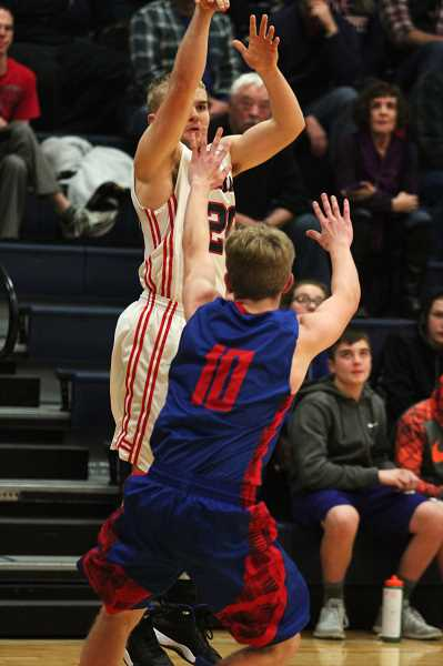 PHIL HAWKINS - Kennedy senior Mason Boen scored nine points — all from behind the 3-point line — against Central Linn.
