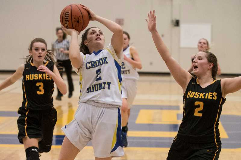 LON AUSTIN/CENTRAL OREGNONIAN - Kennedy Buckner goes up for two of her game-high 12 points as the Crook County Cowgirls defeated the Sweet Home Huskies 51-18 Friday night in non-league basketball action.