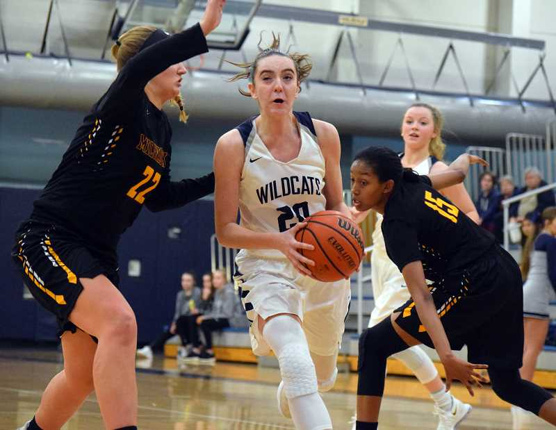SPOKESMAN PHOTO: TANNER RUSS - Wilsonville junior Emily Scanlan led the team in scoring against Milwaukie with 18 points.