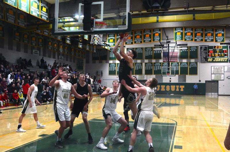 TIMES PHOTO: MATT SINGLEDECKER - Southridge senior Bradley Bickler puts up a short bank shot against Jesuit in Metro League action.