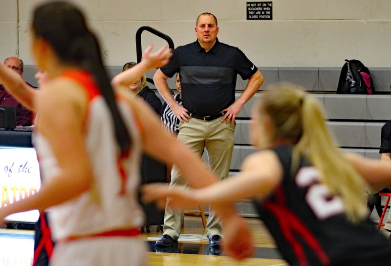 REVIEW/NEWS PHOTO: JIM BESEDA - Gladstone coach Glenn Hopkins, a former assistant at Oregon City High School, was handed the reins to the Gladiators' girls' basketball program in the fall.