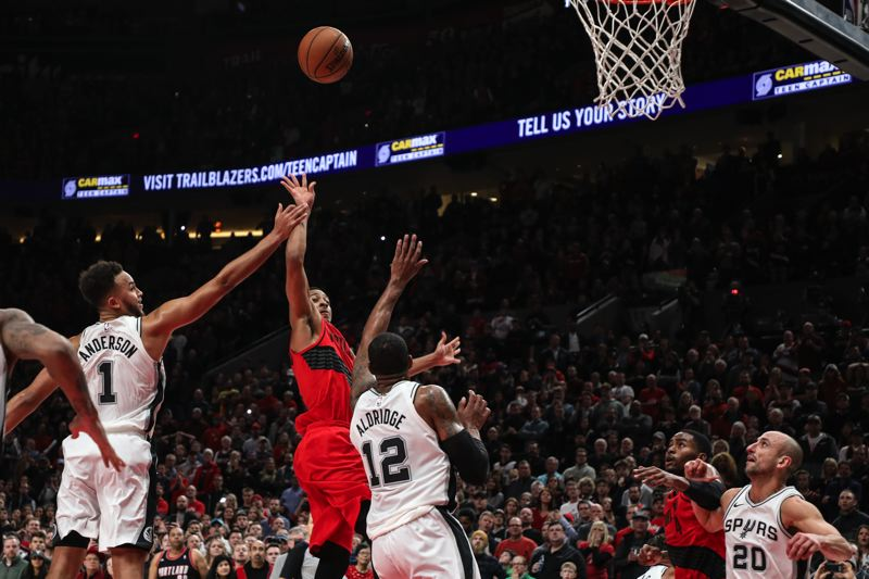 TRIBUNE PHOTO: DAVID BLAIR - CJ McCollum of the Trail Blazers gets off the decisive shot in the final seconds Sunday night against San Antonio.