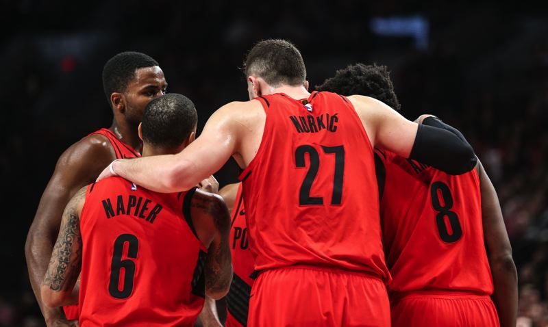 TRIBUNE PHOTO: DAVID BLAIR - The Trail Blazers huddle during their Sunday night game against the San Antonio Spurs.