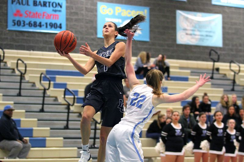 REVIEW PHOTO: MILES VANCE - Lake Oswego junior guard Taylor Anders soars in to score during her team's 54-40 win at Lakeridge High School on Friday night.