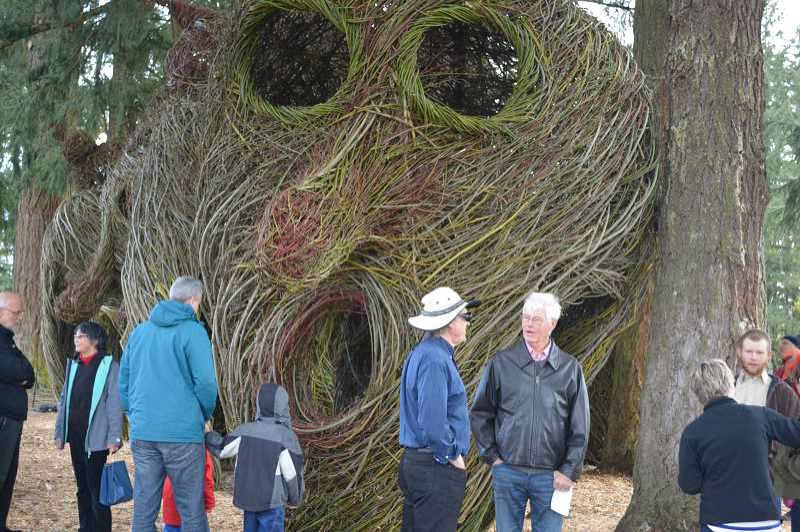 HILLSBORO TRIBUNE FILE PHOTO - Artist Patrick Dougherty (at right, black jacket) engaged the community in building a series of stickwork sculptures last year in Orenco Woods Nature Park. Similarly, the new Artist-in-Our-Community program will engage citizens to partake in art-making.