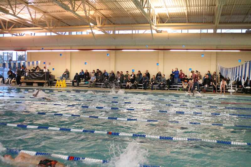 PIONEER PHOTO: CONNER WILLIAMS - The Molalla Aquatic Center was filled with people for a high school swim meet on Friday, Jan. 5. The high school swim team has had access to the pool, but it has been closed to the public since August 2014.