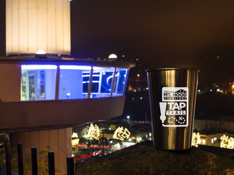 PHOTO COURTESY: CLACKAMAS COUNTY - Mt. Hood Territory Tap Trails official pint glass pays a visit to the Municipal Elevator in Oregon City.