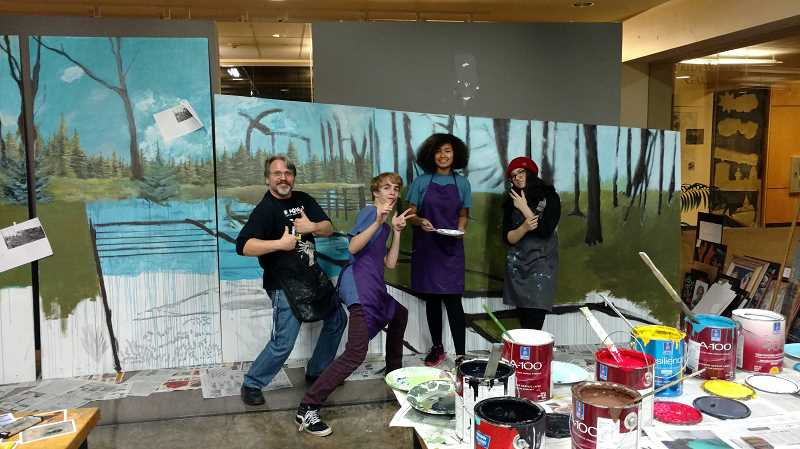 SUBMITTED PHOTO  - From left, Christopher Shotola-Hardt, sophomores Donald Nuffer, Elaysia Gates and Maile Campos work hard on phase one of the mural project.