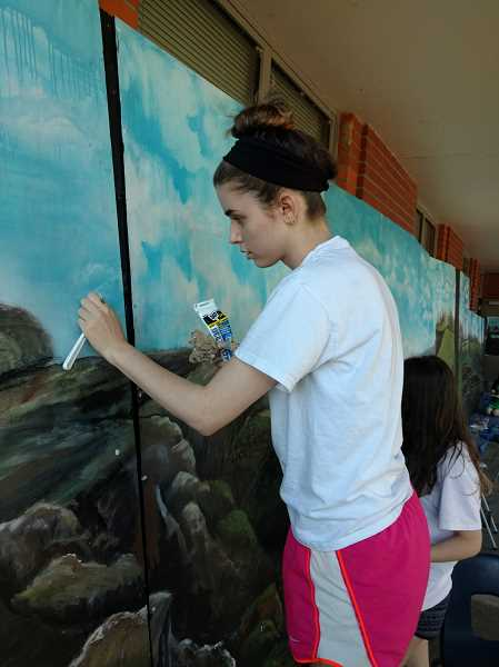 SUBMITTED PHOTO  - Senior Lauren Flick is part of the group of art club students working on the CREST mural project.