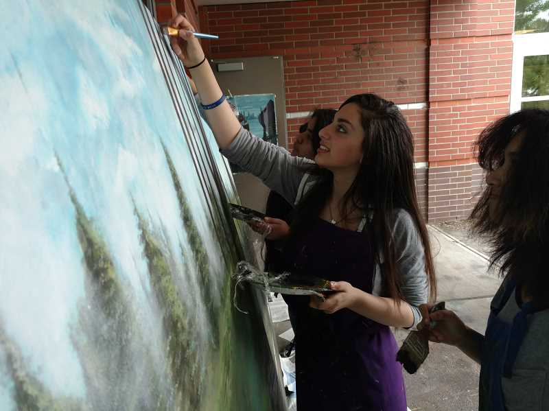 SUBMITTED PHOTO  - Sophomore Rodayna Abdelhalim uses a special landscaping technique to paint the trees.