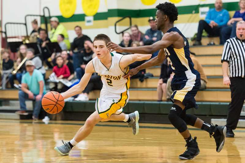 NEWS-TIMES PHOTO: CHRISTOPHER OERTELL - Gaston's Tristan Lund dribbles around a City Christian defender during their Jan. 5 game at Gaston High School.