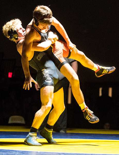LON AUSTIN/CENTRAL OREGONIAN - Pacer Quire lifts a wrestlers in a match earlier this year. Quire went 6-1 in the Rollie Lane Invitational as he finished third at 126 pounds. Quire's high finish helped the Cowboys to a second place finish in the team scoring.