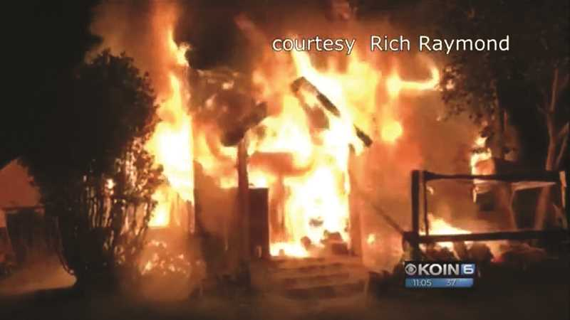 COURTESY PHOTO: KOIN 6 NEWS VIA RICH RAYMOND - A house on East Lincoln Street in Woodburn went up in flames minutes before the stroke of midnight on New Year's Day. A neighbor captured the flames of a house that is said to have been abandoned.