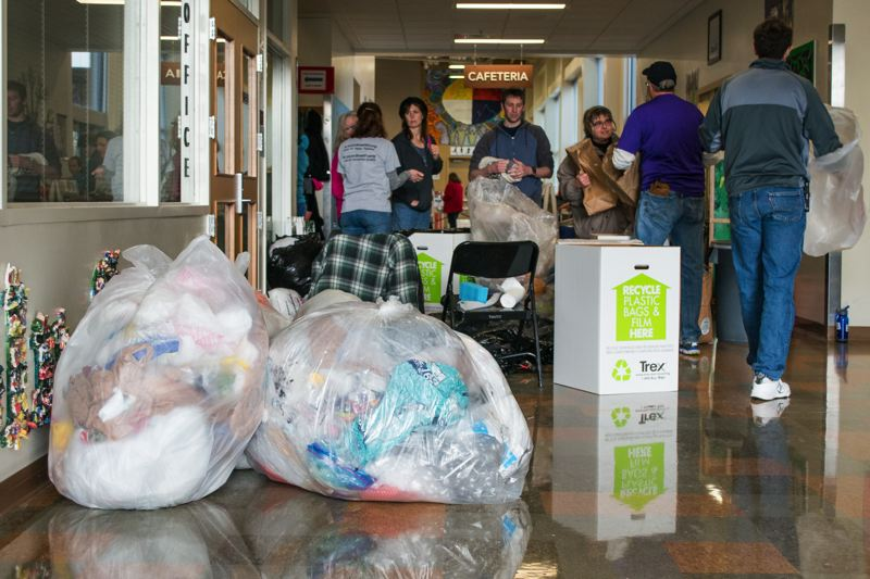 NEWS-TIMES PHOTO: CHRISTOPHER OERTELL - Large bags of grocery bags and other plastic wait to be turned in for recycling during the PlanetCon event at Lincoln Street Elementary School in Hillsboro.