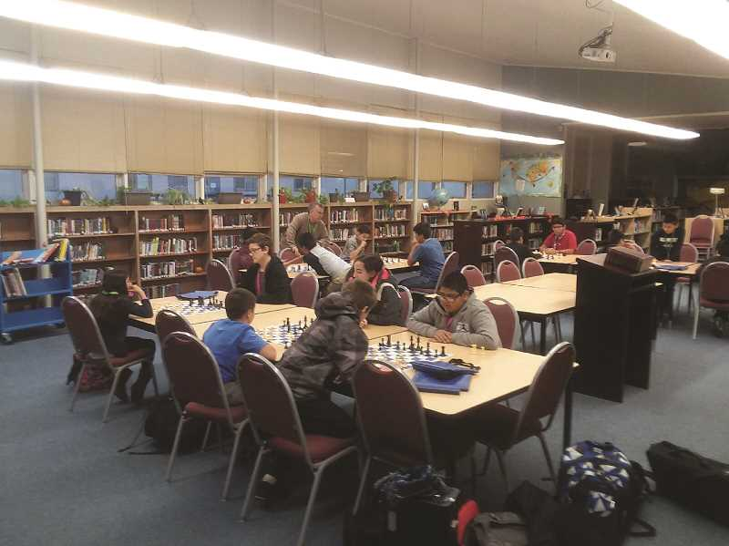 COURTESY PHOTO: DAVE LADUCA - Students at French Prairie Middle School gather in the school library before classes start to play chess. The growing popularity of chess at the school has been part of the reason the library is hosting a chess tournament this weekend.