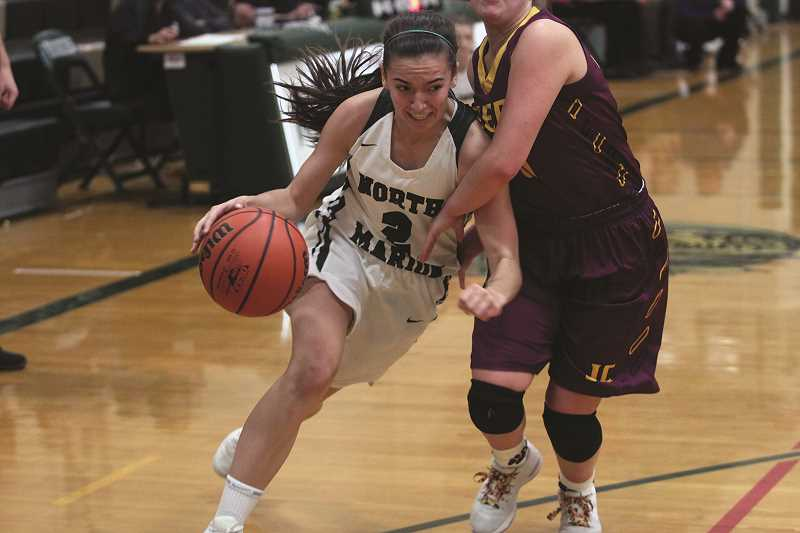 PHIL HAWKINS - North Marion senior Ally Umbenhower drives to the paint in the Huskies' 49-29 win over No. 5 Junction City on Thursday. Umbenhower finished tied with a team-high 12 points, eight of which came in the first quarter.