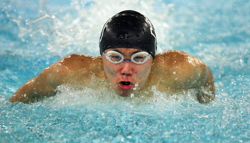 REVIEW PHOTO: MILES VANCE - Lake Oswego senior Andrew Liu races to second place in the 100-yard butterfly during his team's 101-69 win over Sherwood at Lake Oswego District Pool on Jan. 4.