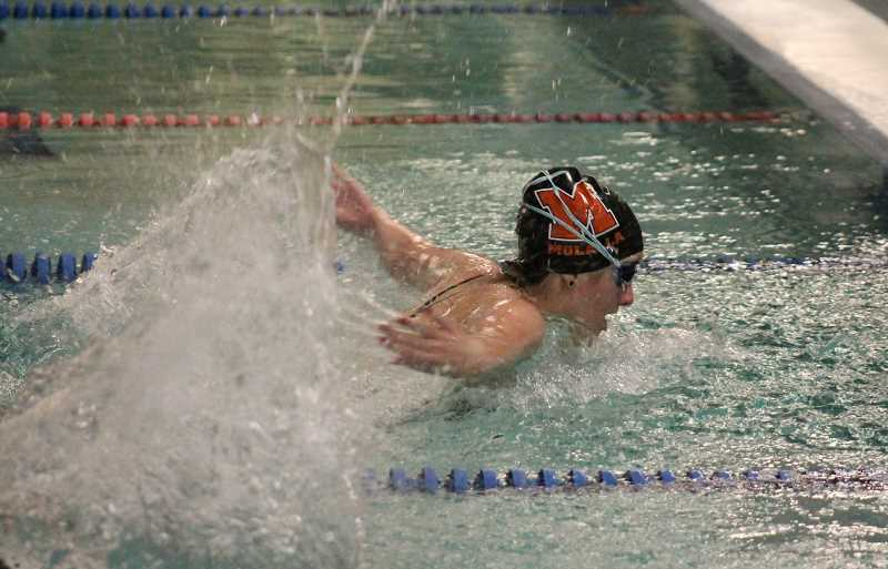 PIONEER PHOTO: CONNER WILLIAMS  - Molalla junior Alisha Issa swims in the 200 Yard Individual Medley Race at the Indians' home swim meet last Friday. Issa took first place in the race with a time of two minutes, 38.10