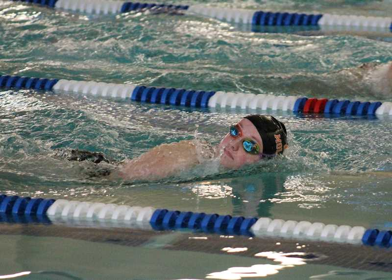 PIONEER PHOTO: CONNER WILLIAMS  - Molalla senior Janiece Moore swims in the girls 200 Yard Freestyle at the Indians' home swim meet last