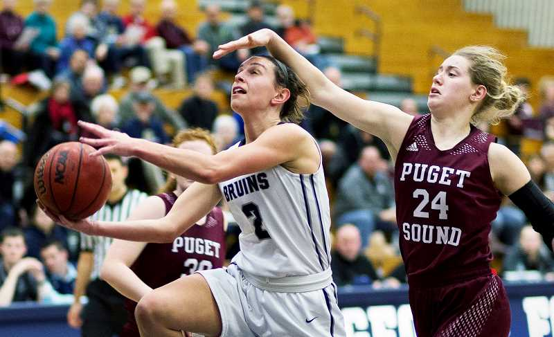 SETH GORDON - George Fox sophomore Emily Spencer ducks under a Puget Sound defender during George Fox's 82-57 rout of the Loggers Friday night.