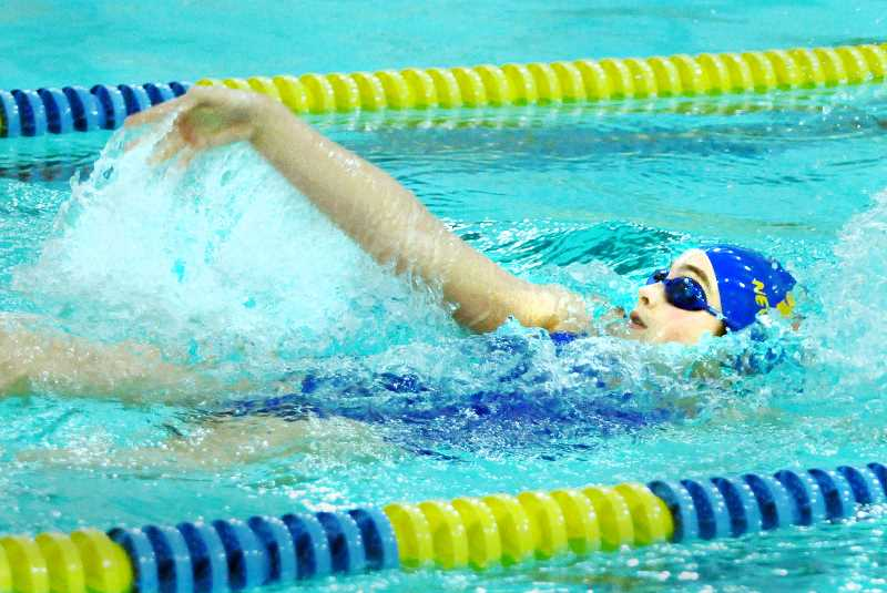 SETH GORDON - Nikki Rubottom swims the backstroke leg of the 200 individual medley during Newberg's Three Rivers League meet versus West Linn and St. Marys Jan. 4. Rubottom was third overall in 2:26.56 as the Tigers bested the Blues but fell narrowly to the Lions.
