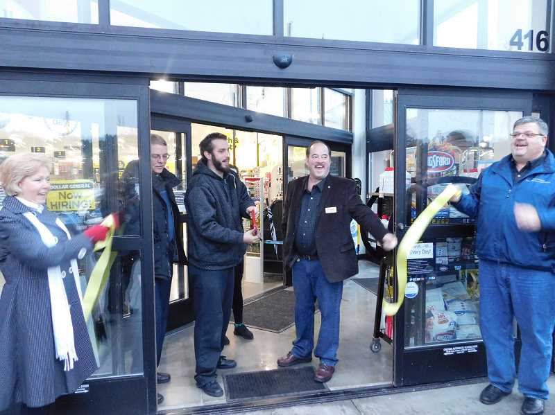 ESTACADA NEWS PHOTO: EMILY LINDSTRAND - Leaders from the city of Estacada and Dollar General cut the ribbon during a grand opening event for the store.