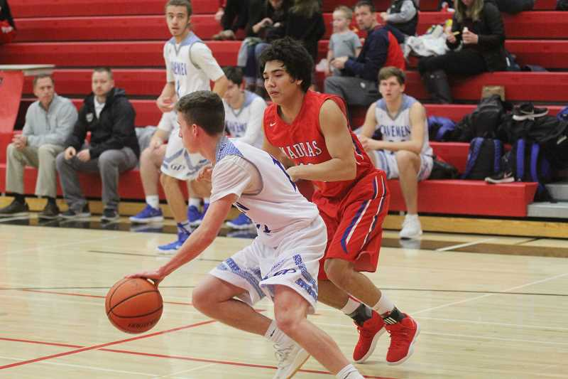 WILL DENNER/MADRAS PIONEER - Madras is aiming to bring a tougher approach to trapping in the backcourt, after the team's pressure broke down in a 105-71 loss to Mountain View last Friday.