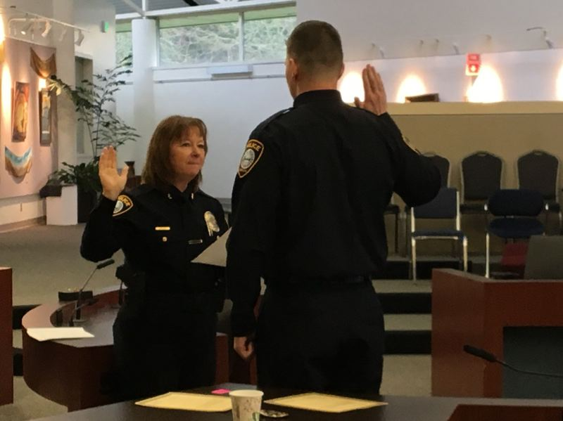 POLICE PHOTO - Gresham Police Chief Robin Sells issues the oath to Recruit Officer James Doyle on Monday, Jan. 8, at Gresham City Hall.